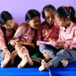Children at Shining Light School in Pune using their new tablets.